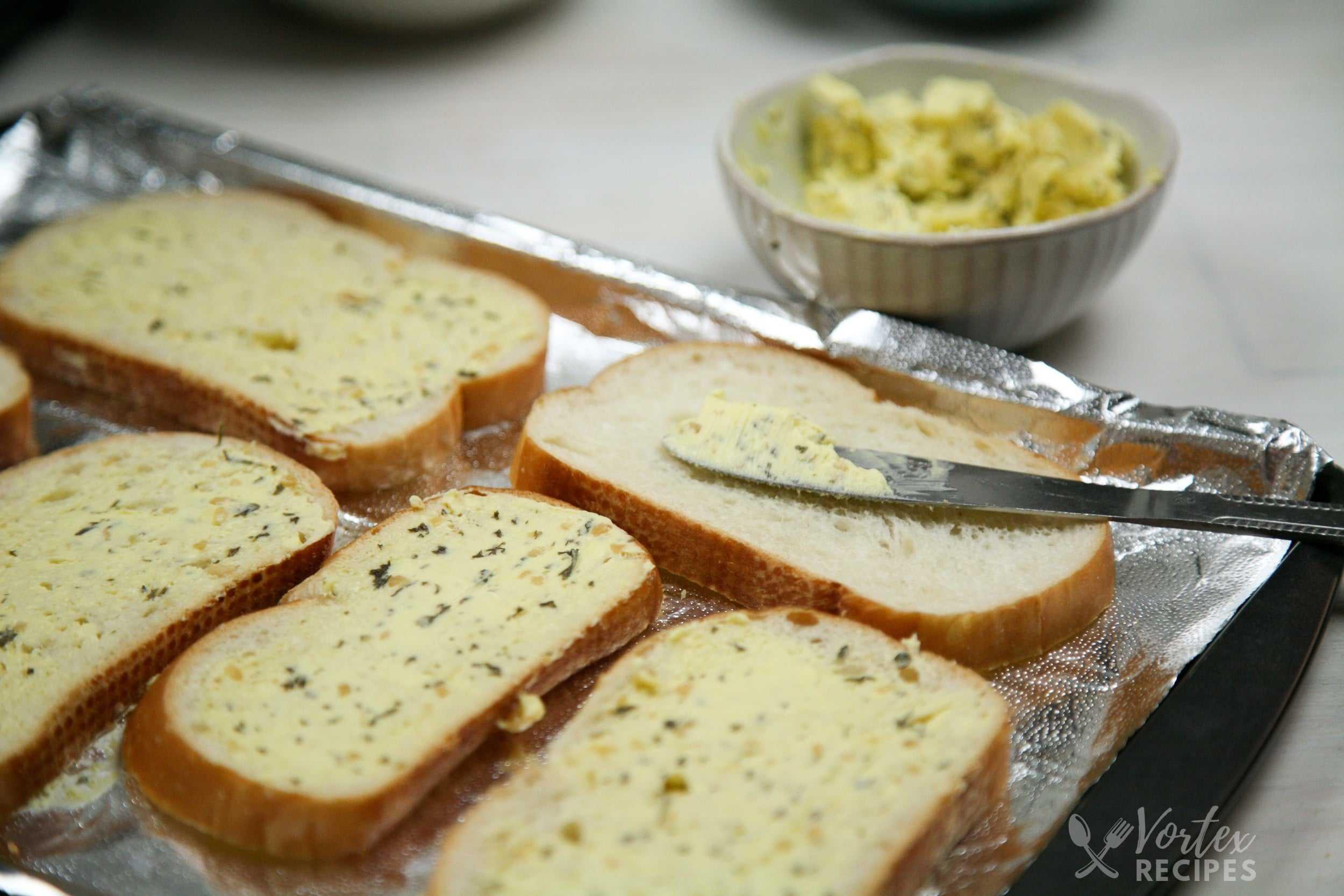 buttering garlic pizza bread